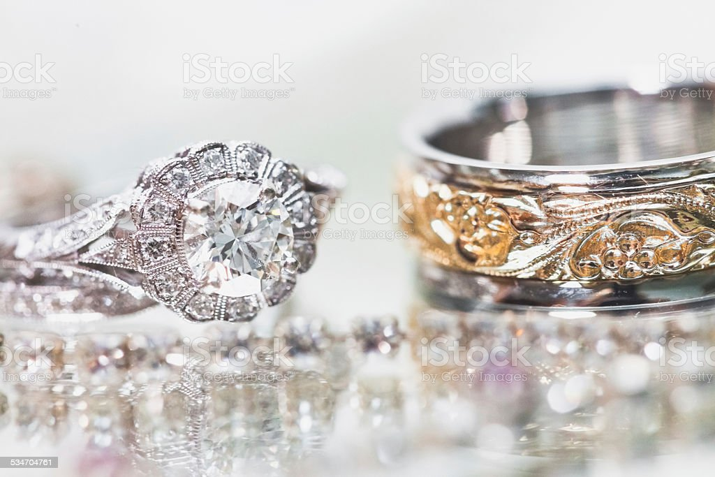 Wedding rings - bride and groom closeup stock photo