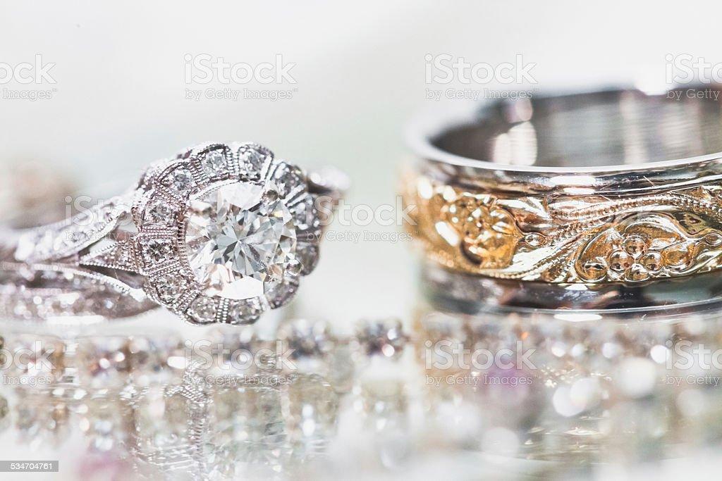Wedding rings - bride and groom closeup stock photo