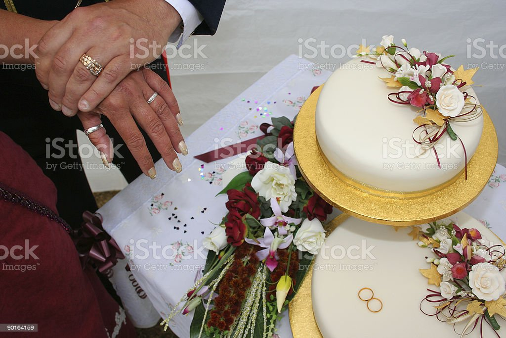 Wedding rings, cake and flowers royalty-free stock photo