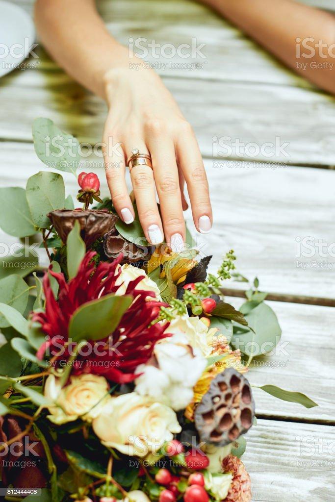 Wedding rings, casket, bride's hands, fresh flowers stock photo