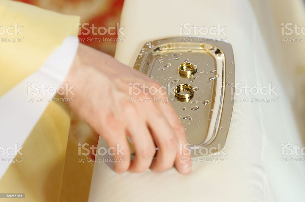 Wedding rings given to bride and groom during ceremony. stock photo