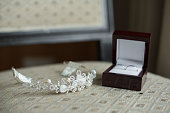 wedding rings in a brown box and a crown