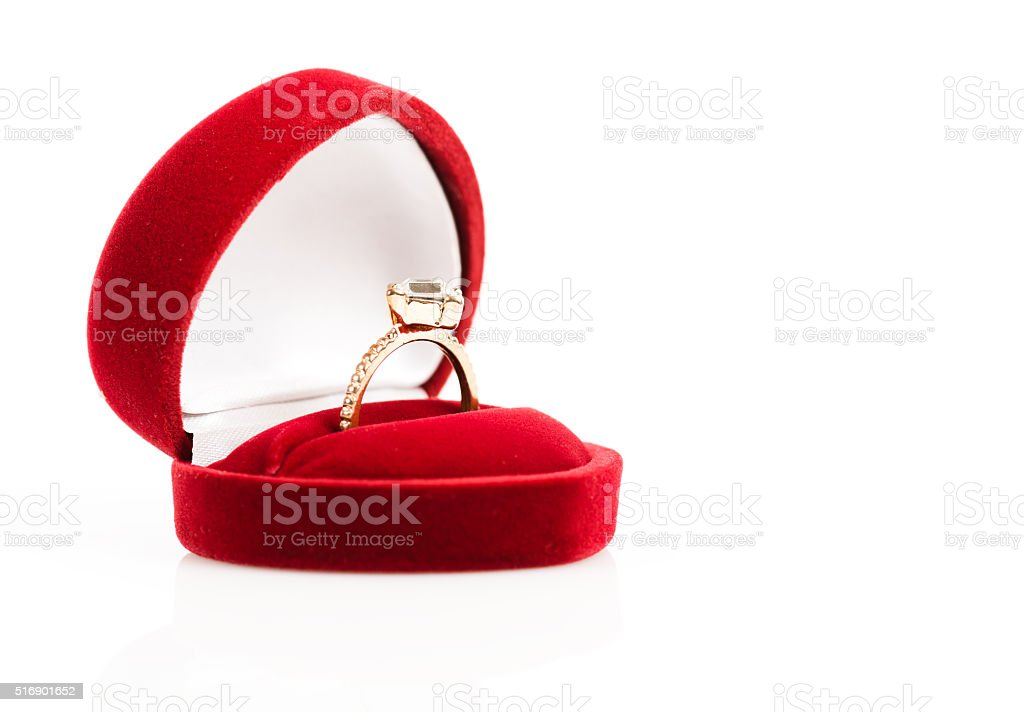 wedding rings in a gift box on white background stock photo