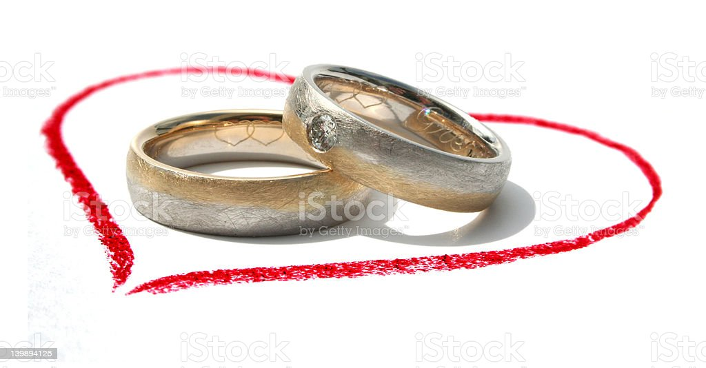 wedding rings in a heart royalty-free stock photo