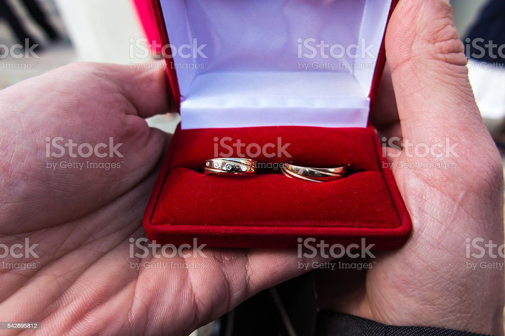 Wedding rings in a red box stock photo