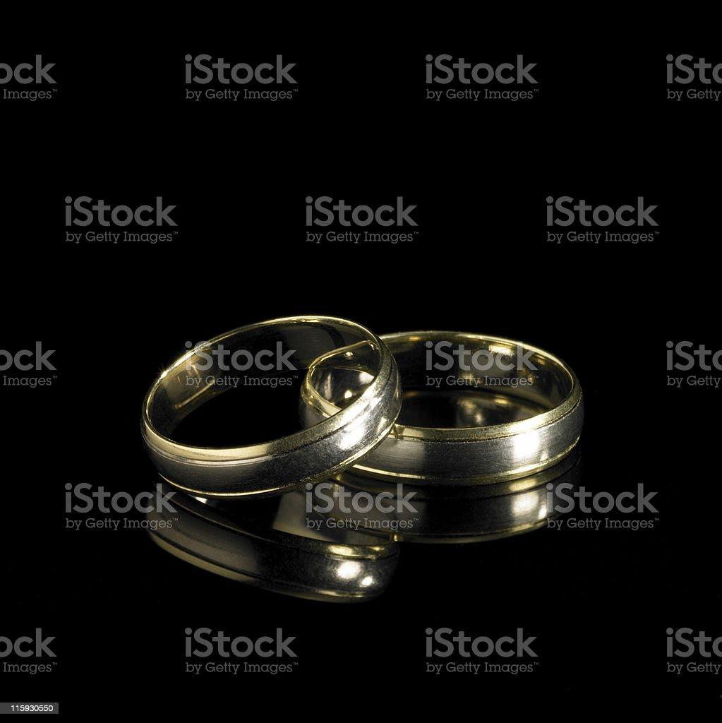 wedding rings in black back stock photo