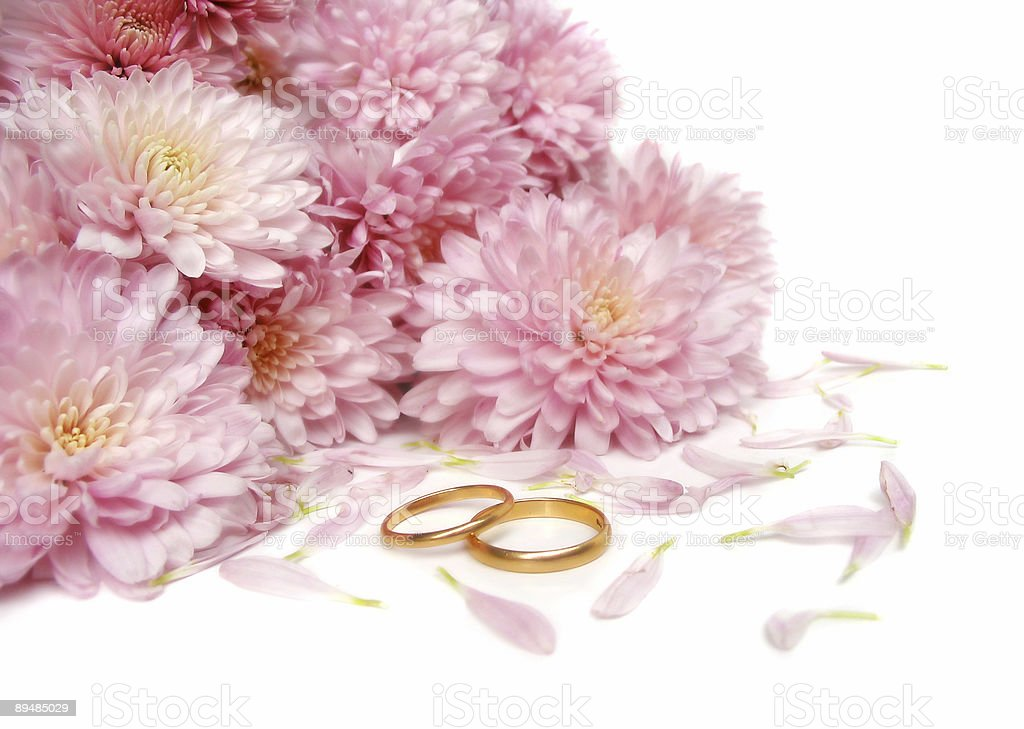 Wedding rings in front of flowers royalty-free stock photo