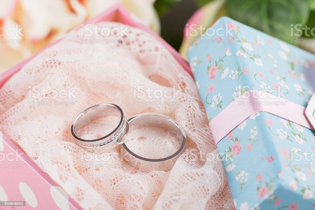 Wedding rings in gift box stock photo