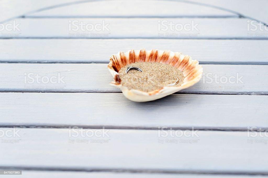 Wedding rings inside seashell stock photo