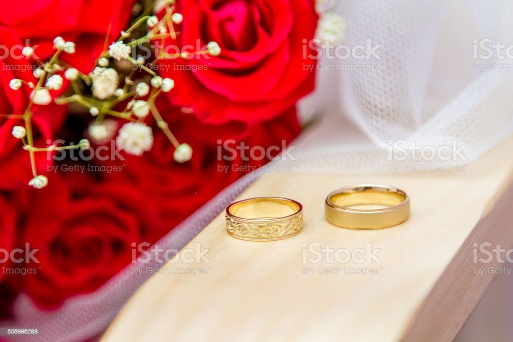 Wedding rings of bride and groom stock photo
