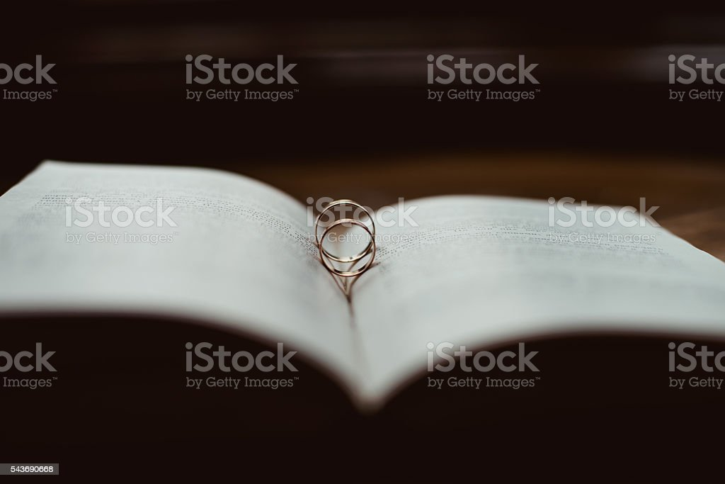 Wedding rings on a Bible stock photo