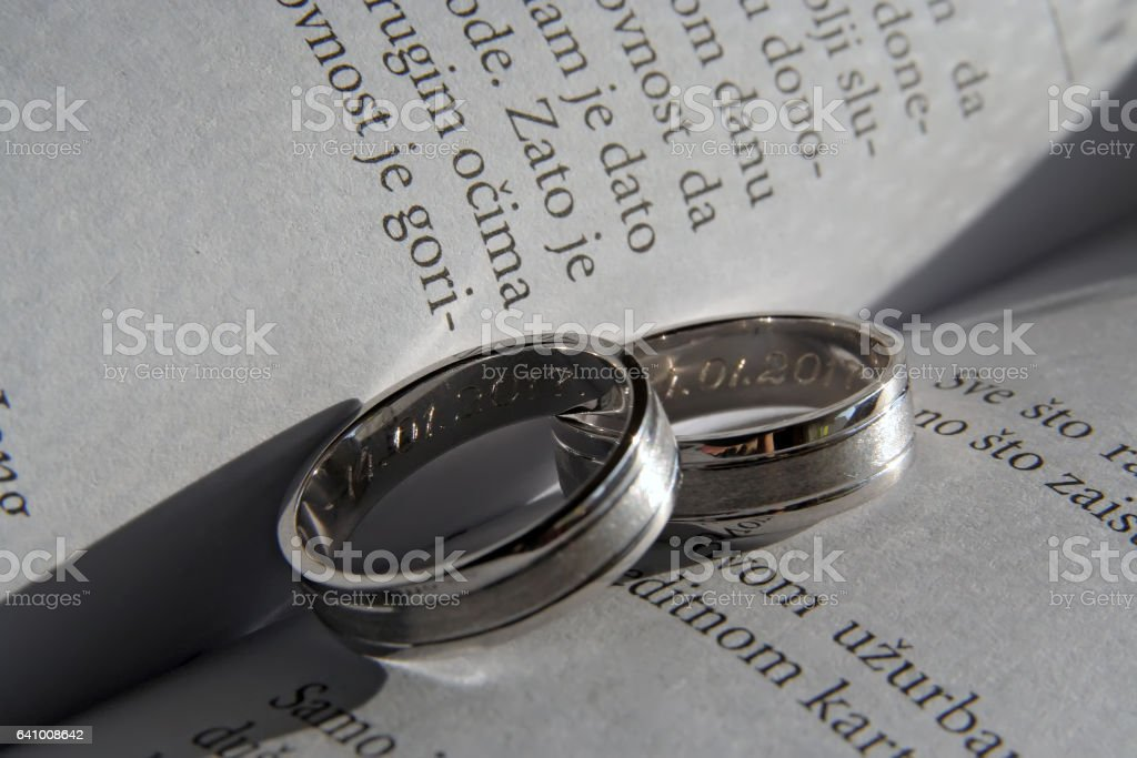 Wedding Rings on a book. White gold Wedding Rings on a book. stock photo