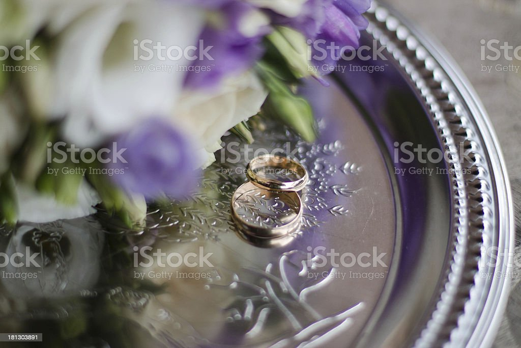 Wedding rings on a plate royalty-free stock photo