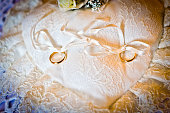wedding rings on a white pillow white