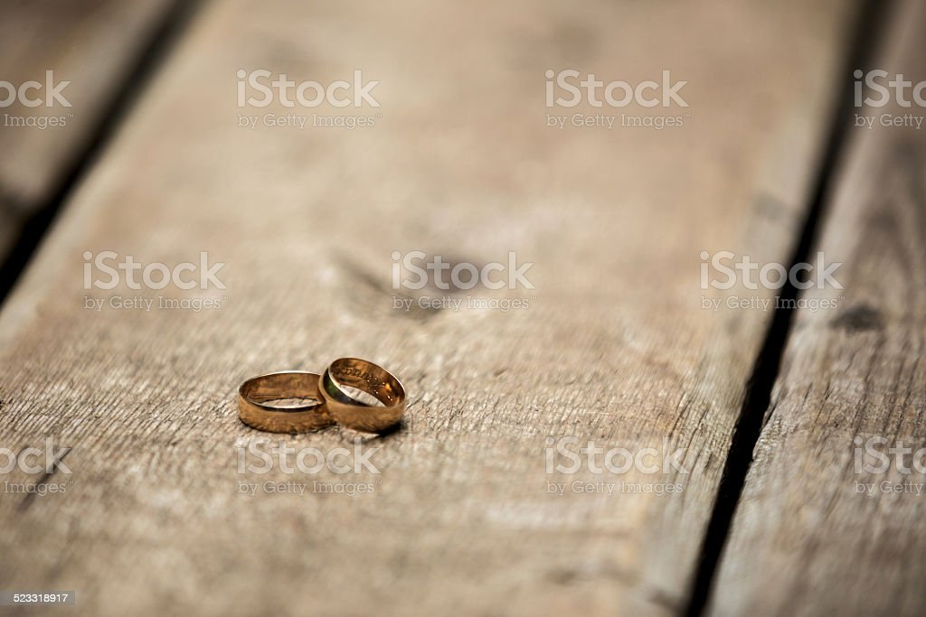 Wedding rings on a wooden bridge royalty-free stock photo
