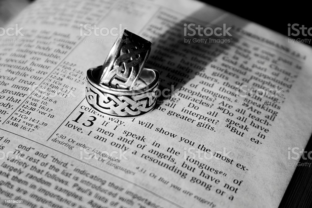Wedding Rings on an open Bible. stock photo