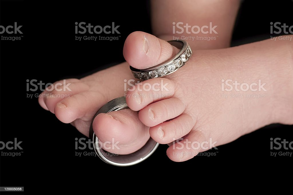 Wedding Rings on Baby Toes royalty-free stock photo