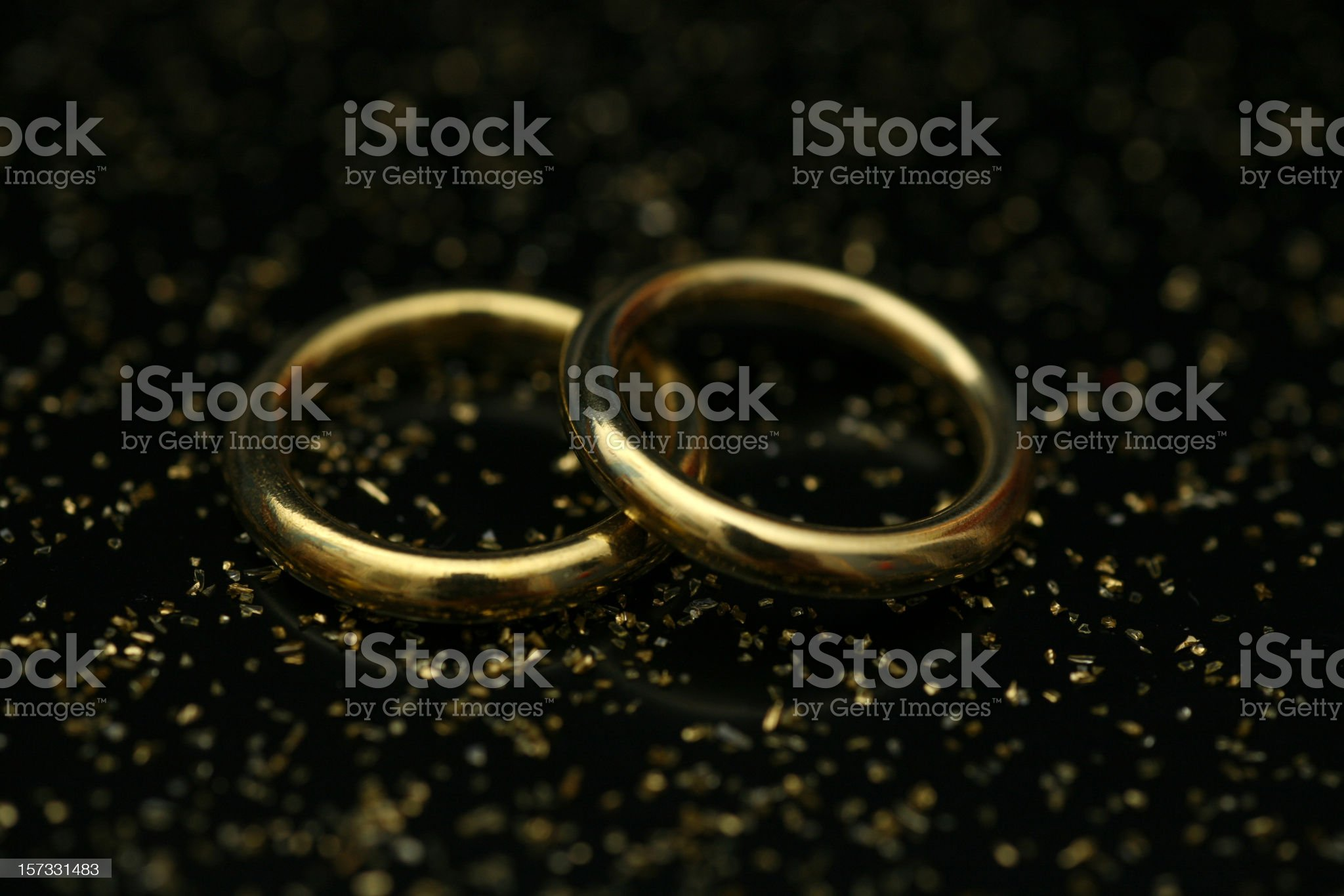 Wedding rings on black royalty-free stock photo