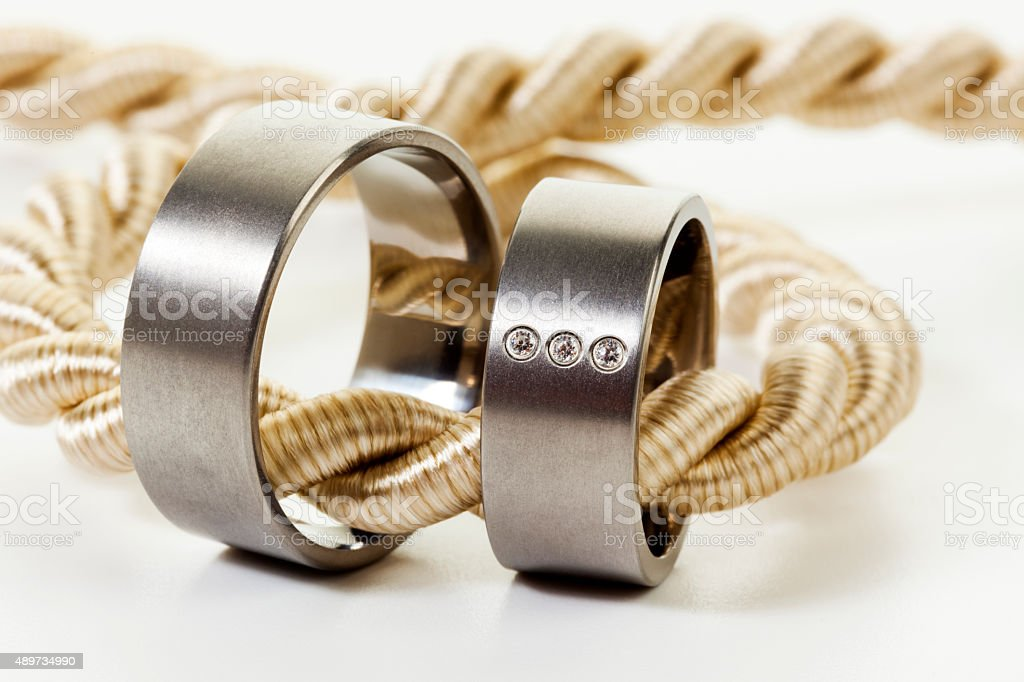 Wedding rings on golden rope stock photo