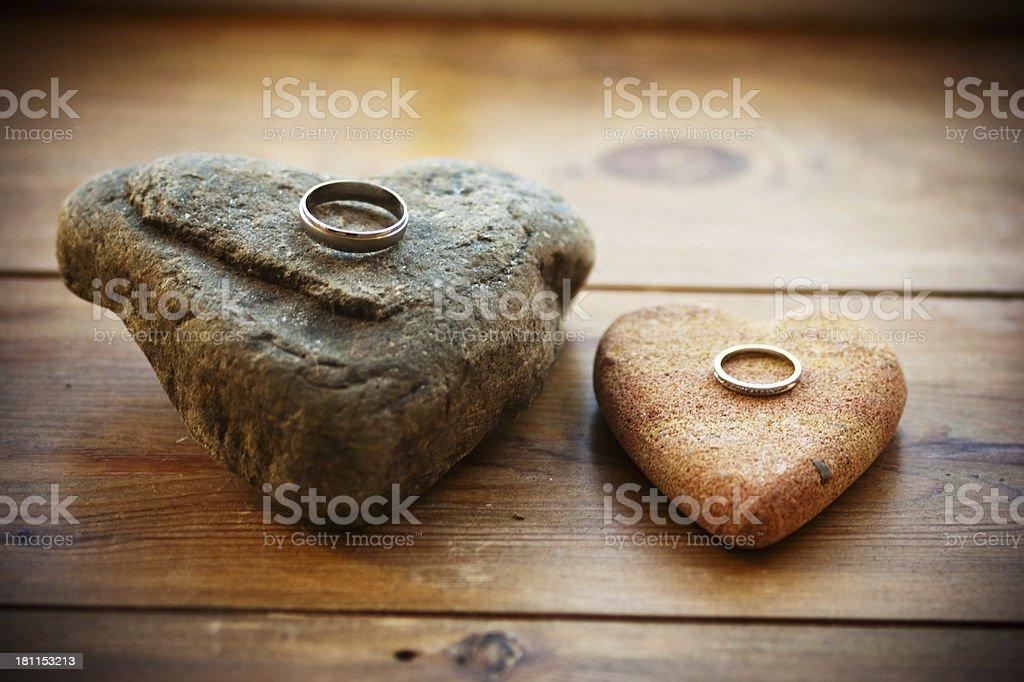 Wedding Rings on heart shaped rocks stock photo