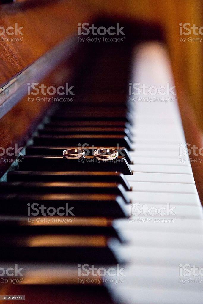 wedding rings on piano royalty-free stock photo
