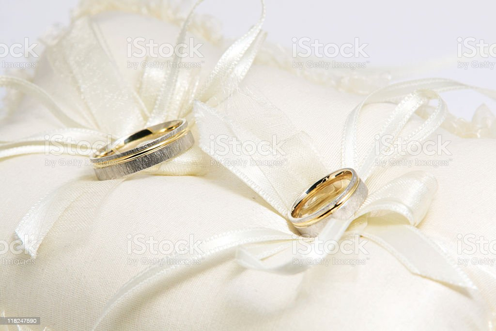 Wedding rings on pillow stock photo