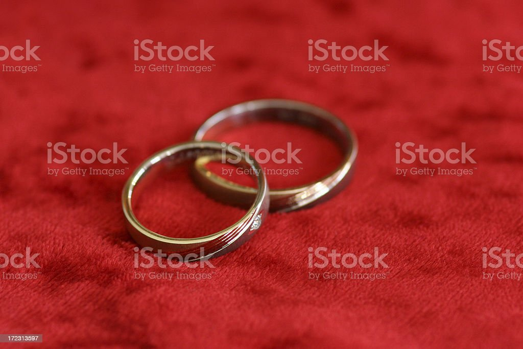 wedding rings on red velvet royalty-free stock photo