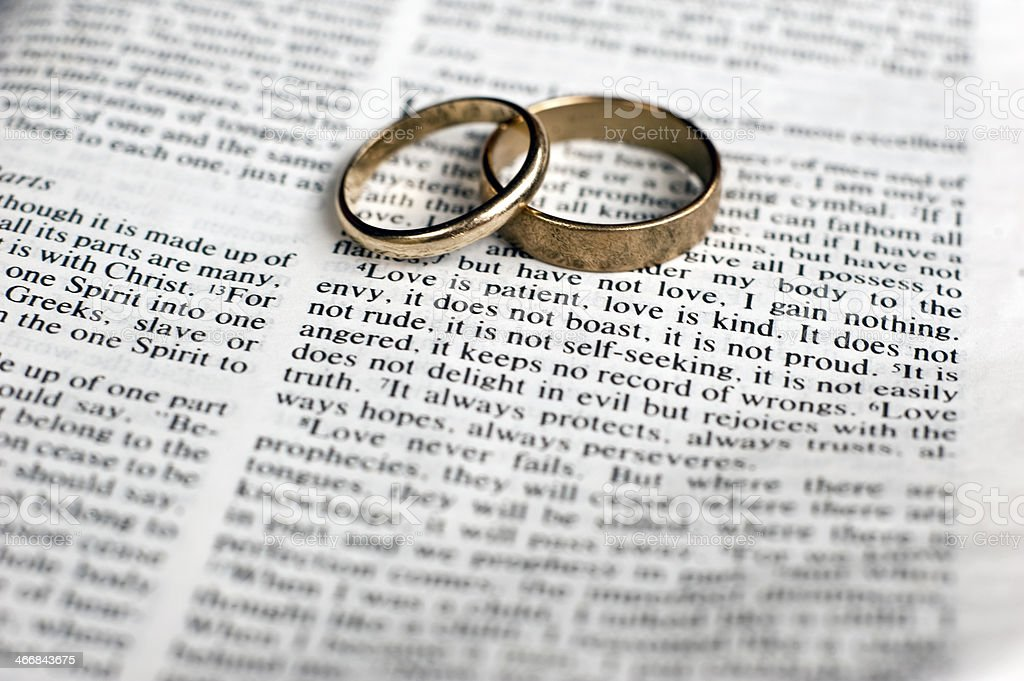 Wedding rings on text stock photo