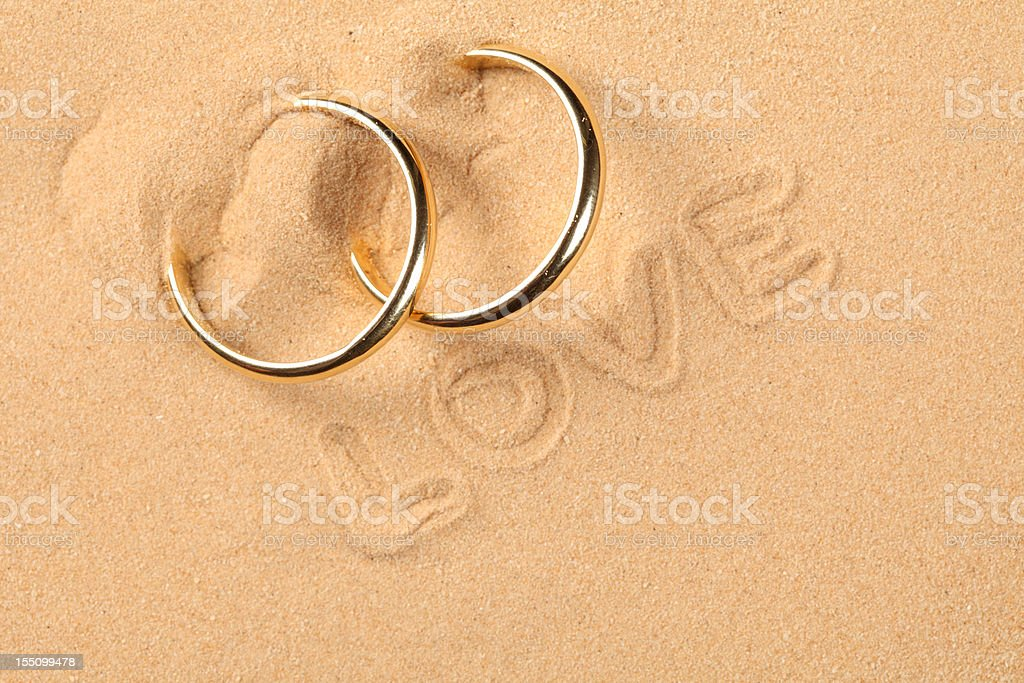 Wedding rings on the beach royalty-free stock photo