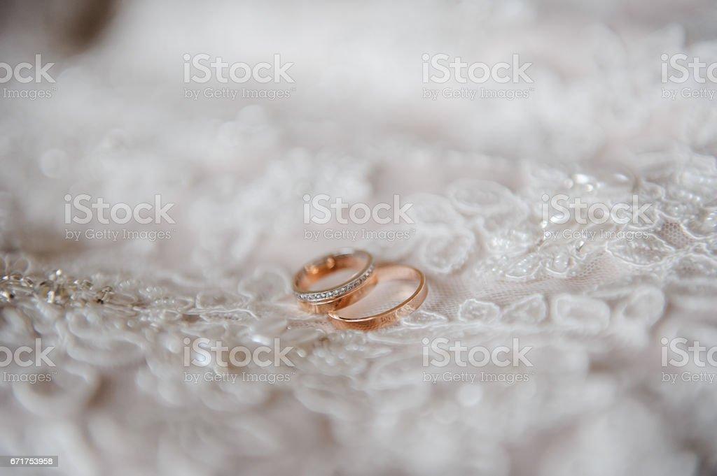 Wedding rings on the wedding dress. stock photo