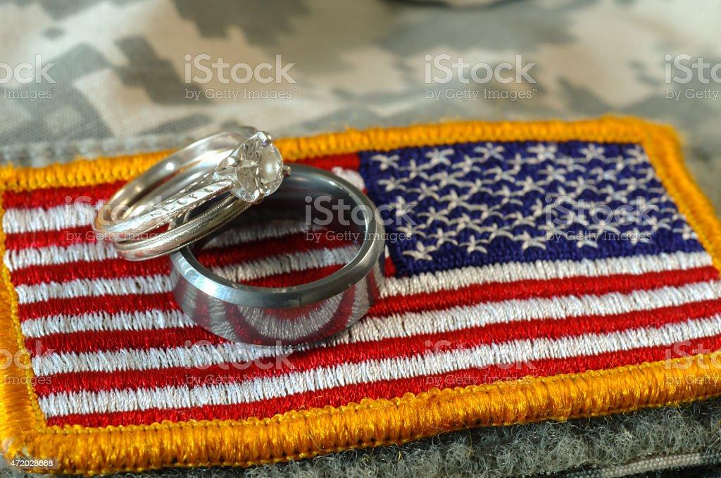 Wedding Rings on US Uniform flag stock photo