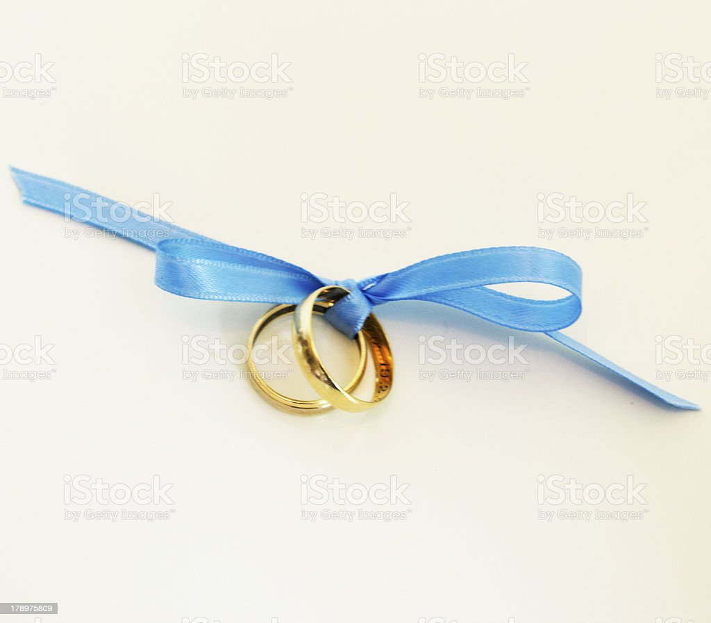 Wedding rings tied with ribbon stock photo