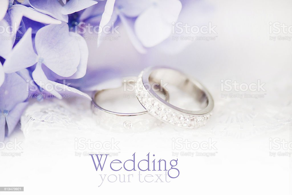 Wedding rings with blue flowers. stock photo