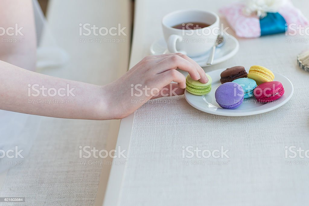 wedding rings with macaroons stock photo