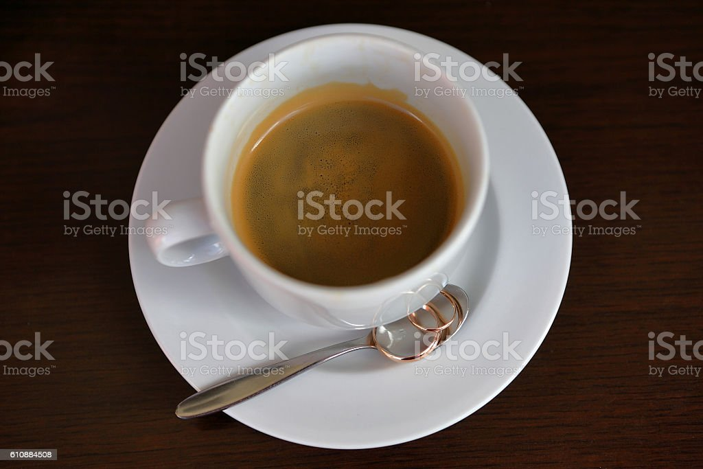 Wedding rings with the cup of coffee stock photo