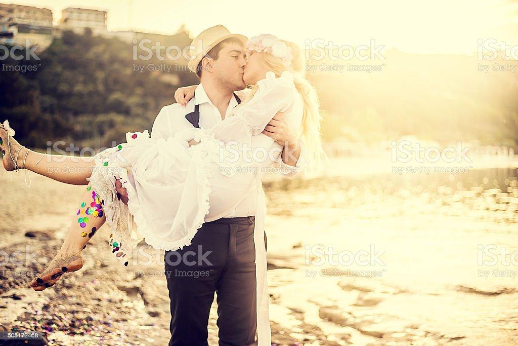 Wedding romance at the beach stock photo