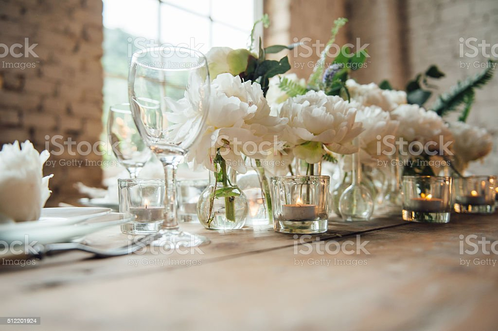 Wedding room decorated loft style with a table and accessories stock photo