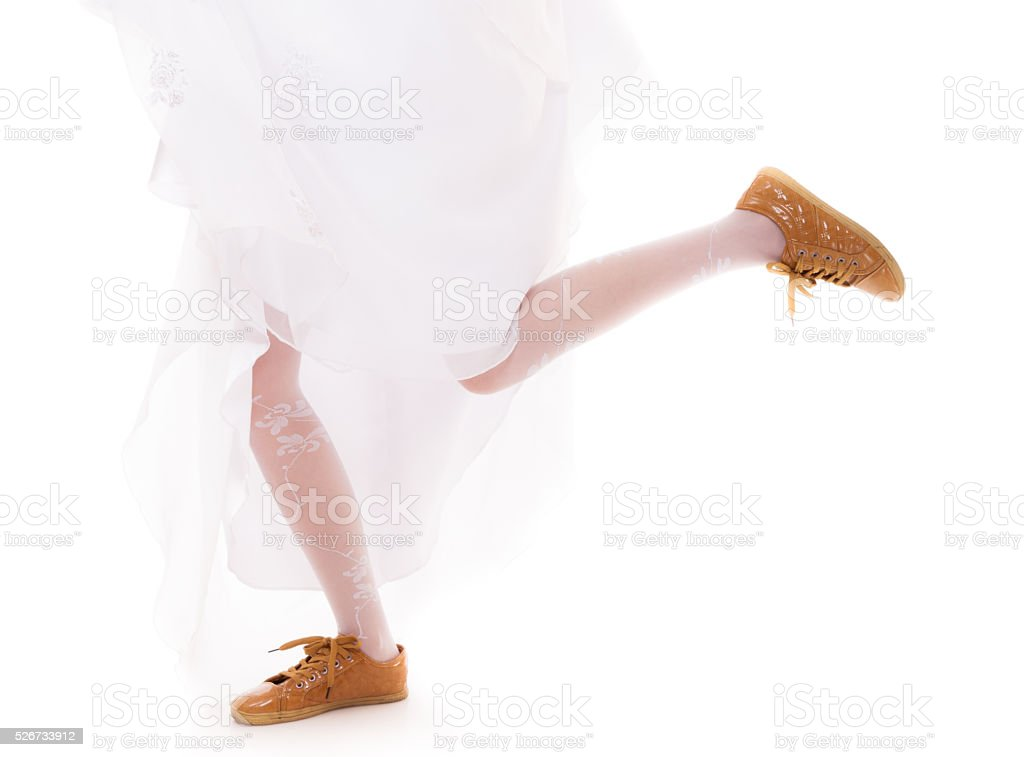 Wedding. Running bride woman legs in sport shoes stock photo