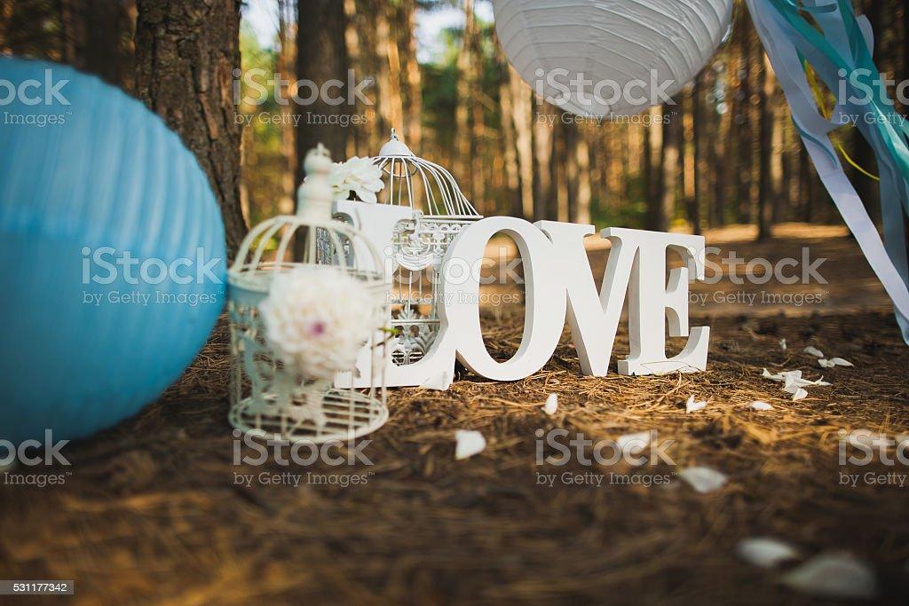 Wedding settings. Love - wooden inscription. stock photo