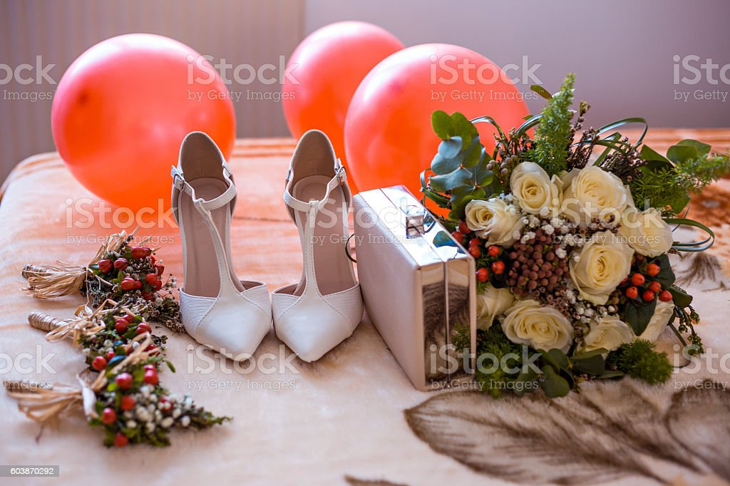 Wedding shoes and purse with flower and balloon decoration stock photo