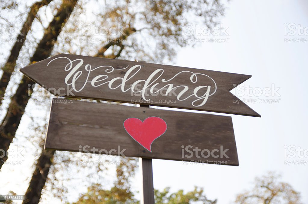 wedding sign with red heart-shape stock photo