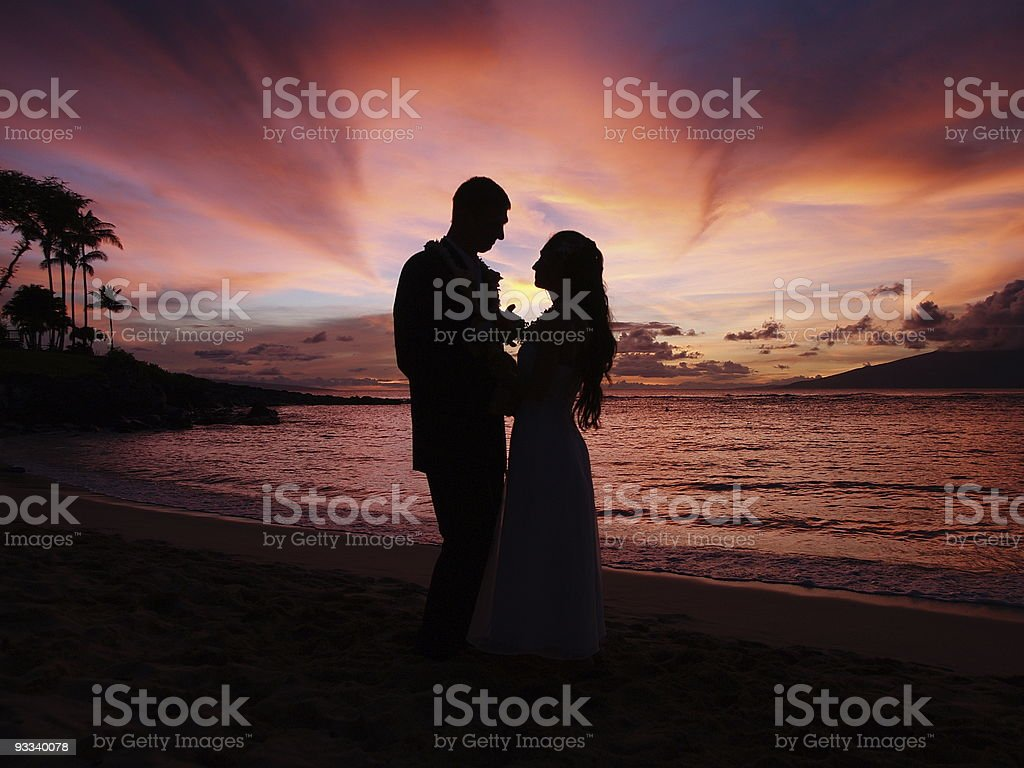 Wedding silhouette on sunset tropical beach stock photo