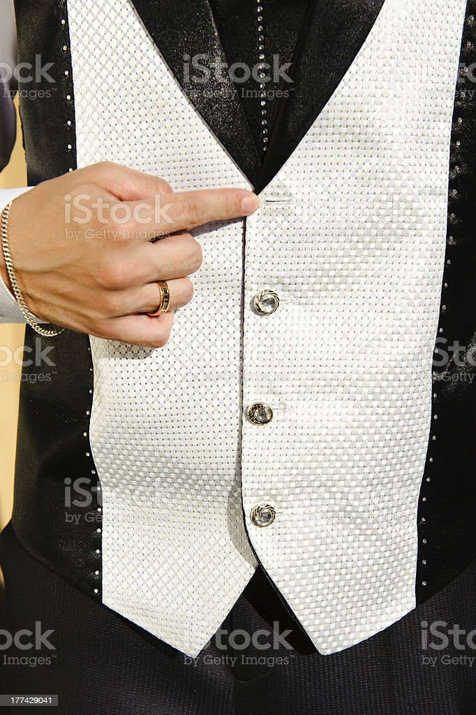 Wedding suit detail with lost buttom stock photo