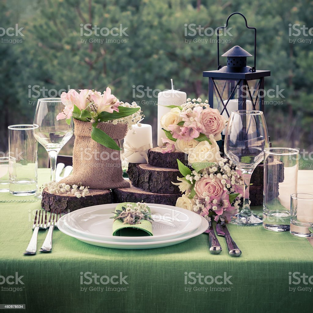 Wedding table setting decorated in rustic style. stock photo