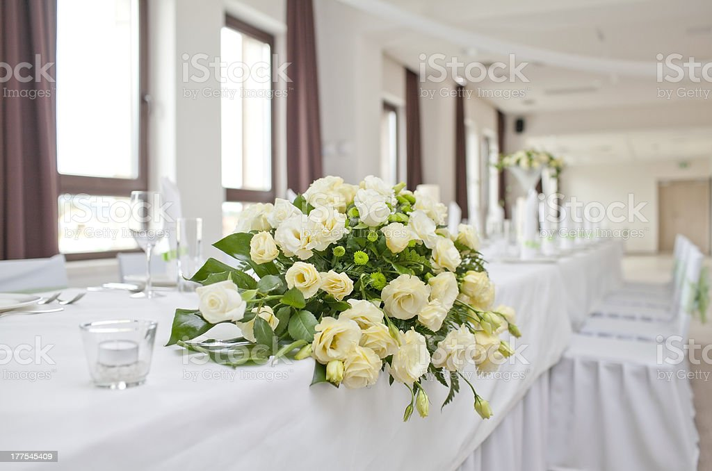 Wedding table with bouquet of roses royalty-free stock photo