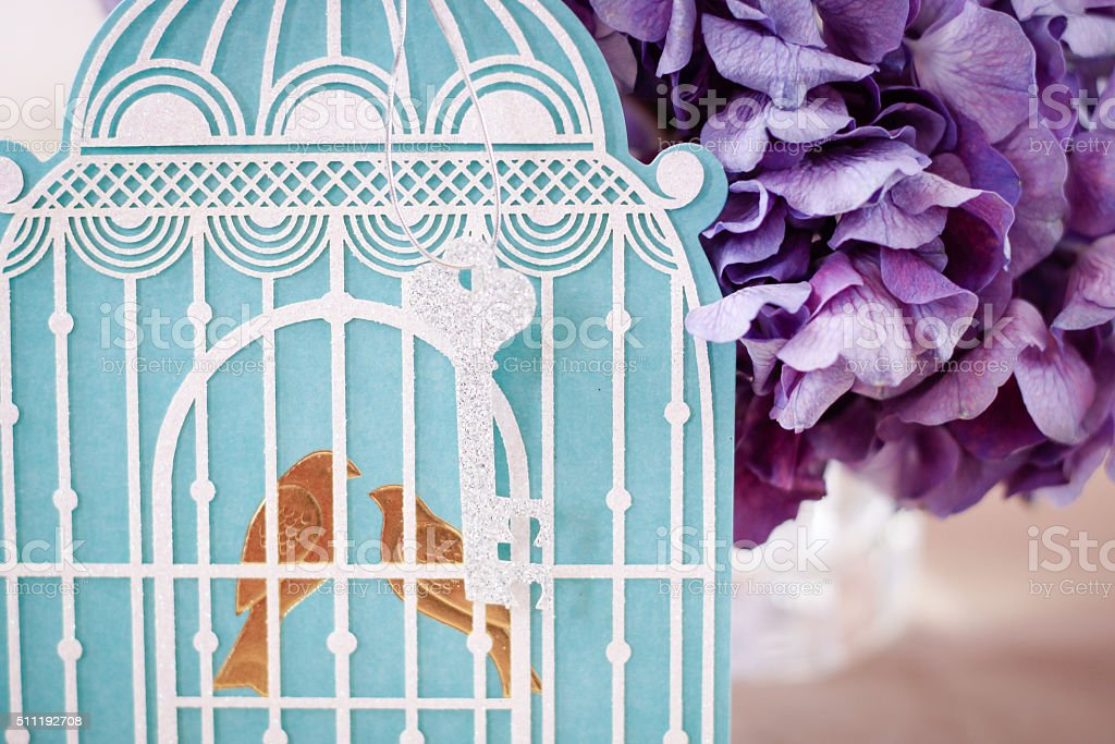 Wedding theme bird cage and hydrangeas stock photo