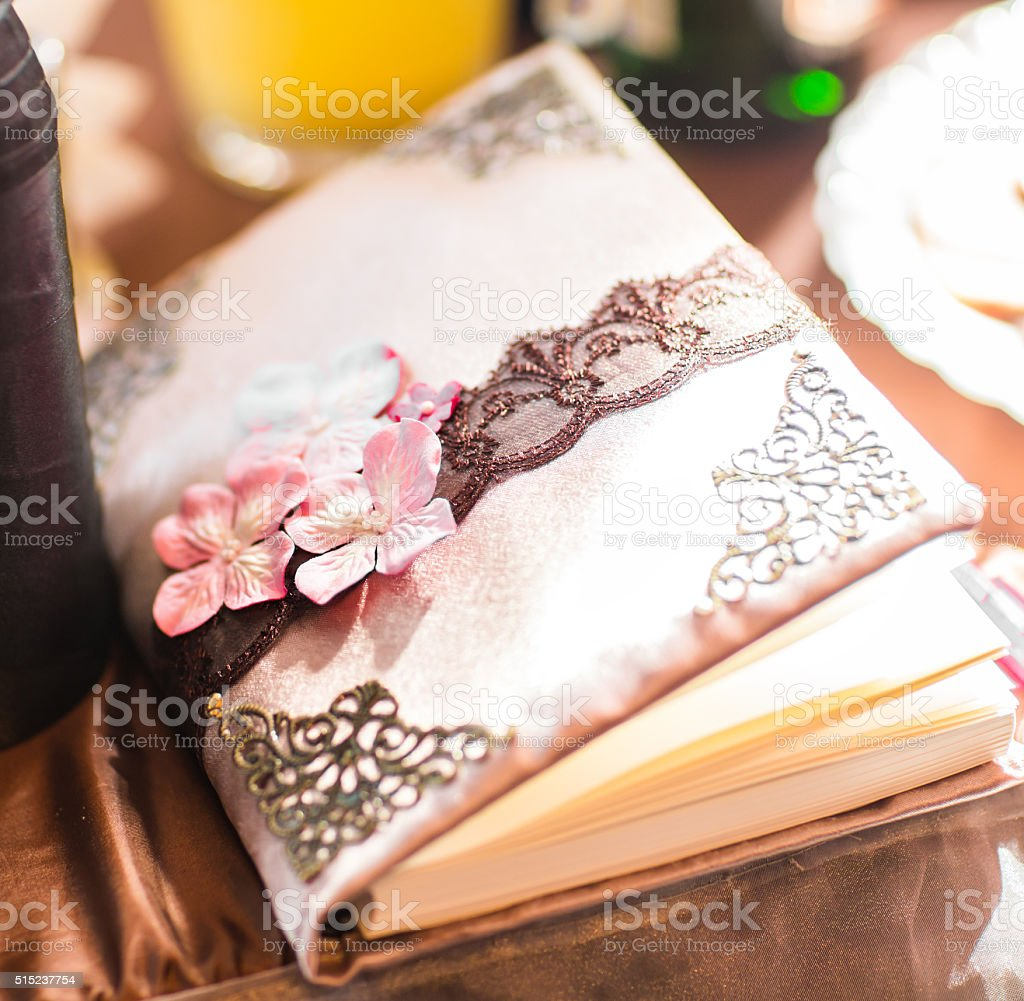 wedding wish book decorated with flowers and lace stock photo