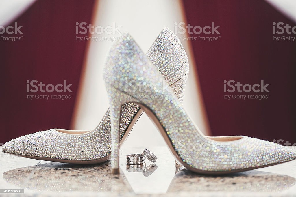 Wedding-ring and woomen shoes acute coe stock photo