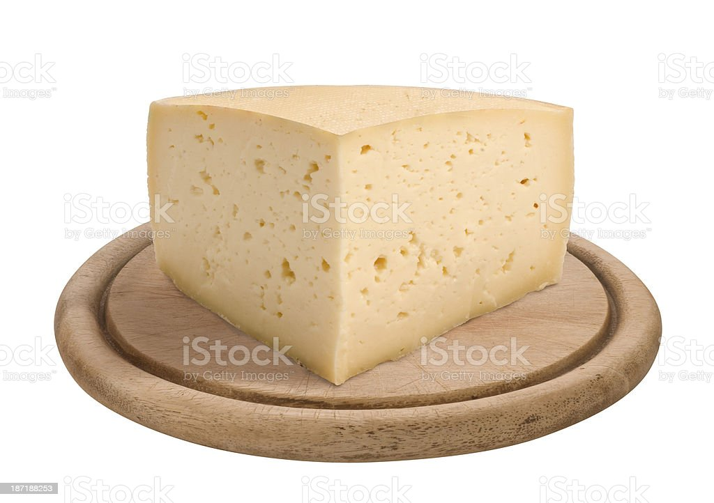 A wedge of cheese on a wooden platter stock photo