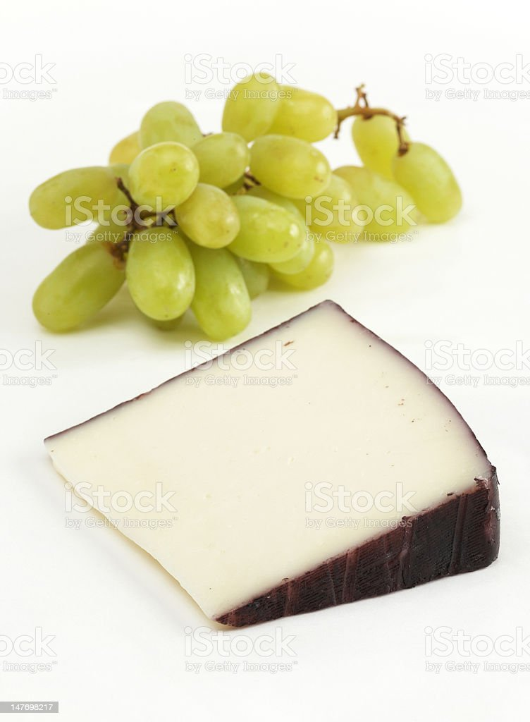 Wedge of hard goat cheese royalty-free stock photo